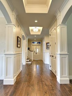 Walnut hardwood floors against white walls and doors - beautiful