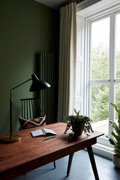 Dark olive green walls for home office area. Dark olive green walls for home office area. Dark Green Living Room, Dark Green Walls, Olive Green Walls, Living Room Decor Green, Olive Green Decor, Living Room Wall Designs, Home Living Room, Home Office Design, Home Office Decor