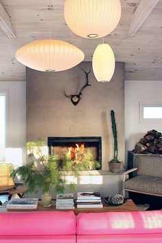 concrete fireplace // midcentury modern // cluster of george nelson bubble lamps // bright pink Scandinavian sofa Interior Design Blogs, Interior Inspiration, Interior Decorating, Rosa Couch, Concrete Fireplace, Fireplace Wall, Fireplace Drawing, Fireplace Candles, Craftsman Fireplace