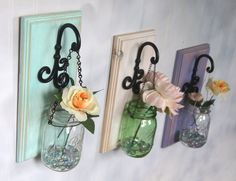TRIO of Hanging Mason Jars, Distressed & Beveled - to be RESTOCKED on 1-27  Add a touch of country home decor to your house to create a unique atmosphere. The hanging mason jar can be painted, clear glass, or tinted green glass. The hanging mason jar is accented with rustic beveled pine. The pine is then painted with care and distressed for the final touch. On the back of each display is a key hole making it easy to hang.  Available options include, Jar Color, Flowers, or Full Bloom (incl...