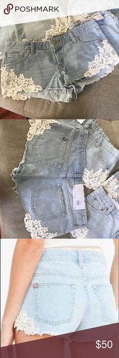 BDG Dolphin low rise shorts Light wash adorable Jean shorts lace detail on sides. NWT!!! Same day shipping!!!! BDG Shorts Jean Shorts