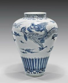 LARGE KOREAN BLUE AND WHITE DRAGON JAR; of high shouldered form, with continuous design of two writhing dragons chasing flaming pearls amid clouds; H: 24""