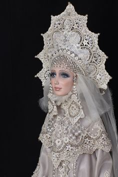 A porcelain doll in a stylized Russian outfit. The outfit is made of lace and decorated with artificial pearls. #kokoshnik  #beauty #Russian #lace