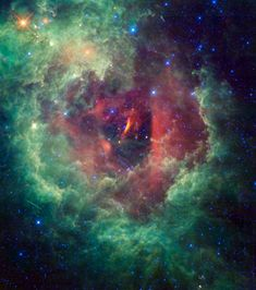 New Cosmic Photo Reveals Eye-Catching Rosette Nebula - This image taken by NASA's Wide-field Infrared Survey Explorer (WISE) shows the Rosette nebula located within the constellation Monoceros (the Unicorn)