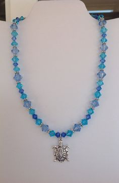 Handmade Blue Glass Necklace with Finely Detailed Turtle Pendant on Etsy, $19.00
