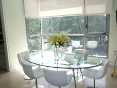 elegant oval glass kitchen table with minimalist modern white chairs for dining area the coolest
