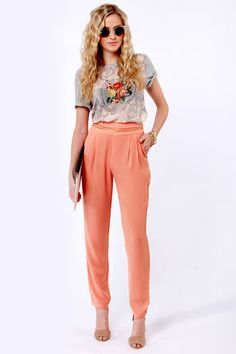 The whole outfit is ok, but I'm loving those coral pants.
