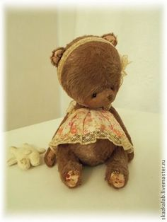 ....i want to tickle the tummy of this sweet little bear....as much as she tickles me with all of that CUTENESS!!...