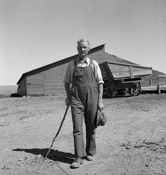 """Chris Ament, on dry land wheat farm of Columbia Basin where he has farmed for thirty three years. """"I won't live to get the benefits of the water, but I hope to be able to see it."""" Washington, Grant County, three miles south of Quincy; photo by Dorothea Lange, August 1939. -- Eyes of the Great Depression 109."""