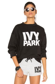 672074cd9c091 Shop for IVY PARK Sweatshirt in Black   White Logo at REVOLVE. Free day  shipping and returns