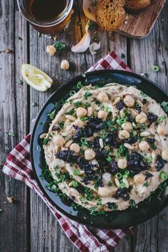 A restaurant style yet Homemade Mediterranean Hummus recipe. This recipe makes the creamiest and most delicious hummus that you can make in minutes. Top it off with pine nuts, chopped olives, and a drizzle of oil for extra deliciousness.