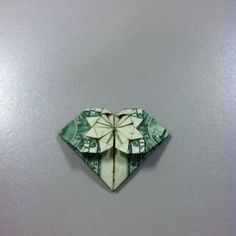 Heart made out of a dollar.
