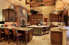 Love, Love, Love this kitchen.  The rustic warmth, coziness and charm, along with functionality and plenty of storage makes it perfect.