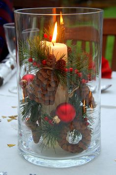 safe table candles. Christmas dinner party table decor with pine cones and ornaments