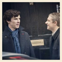 Benedict Cumberbatch and Martin Freeman share a joke on the set of The Reichenbach Fall