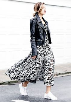 Carmen Hamilton wears a black and white maxi dress, leather jacket, and adidas sneakers