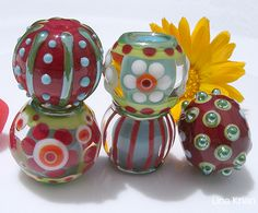 Lina Khan | Lampwork Beads: AYOKA - Encased turqouise Beads with Flowers and Stripe Patterns