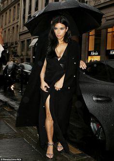 Kim Kardashian displays cleavage in a thigh-high split black dress while in Paris  #dailymail