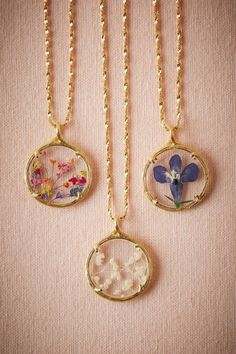 gold keepsake necklace, perfect for gifting to your bridesmaids | Pressed Flower Necklace fromBHLDN
