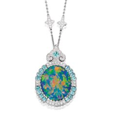 PLATINUM, BLACK OPAL, DIAMOND AND TOURMALINE NECKLACE Suspending a pendant centering an oval-shaped black opal weighing 12.34 carats, framed by 13 tourmalines weighing approximately 1.50 carats, the pendant and chain further set with round diamonds weighing approximately 1.25 carats, length 17¾ inches. Estimate 40,000 — 60,000 USD