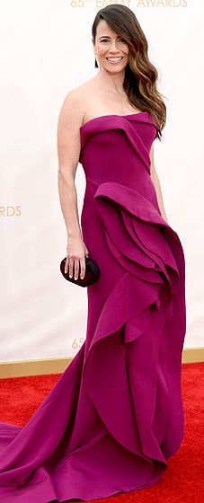 Linda Cardellini strikes a pose on the red carpet at the 2013 Emmy Awards