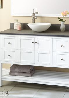 Ideal for your new powder room, this vanity has ample storage space and an open design for organization. The brushed nickel hardware and the brilliant white finish make this adaptable to a multitude of decor styles.