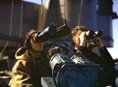 Officers and men observing the landing beaches through binoculars on the bridge of the aircraft carrier HMS Formidable