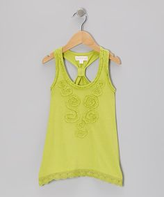 Swirls of ruffles and eyelet trim bring the best out of this tank's design. Cut from soft fabrics, it has a knotted racerback that's sporty yet classic on little girls.100% cottonMachine wash; hang dryImported