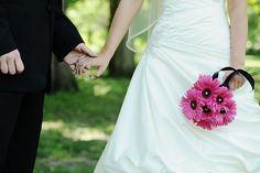 my husband & i and my hot pink gerber daisies!