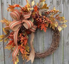 Fall Door Wreath  This beautiful fall wreath is characterized by a lovely wired burlap bow with a printed stripe detail. Riotous Autumn leaves and