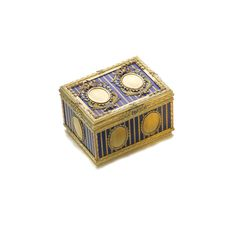 A Four-Colored Gold and Enamel Snuff Box in 18th century taste, circa 1970 --- Rectangular, the lid with jugate oval panels within elaborately chased coloured gold swag and husk frames on a striped blue enamel ground within chased borders, the sides similarly decorated, indistinct maker's mark. | sotheby's ge1305lot767lxen