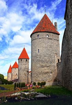 Towers' Square in the Old Town of Tallinn, Estonia is one of Europe's best preserved medieval fortifications. Its square is now a children's playground and is host to the annual summer Tallinn International Flower Festival. by totororo.roro