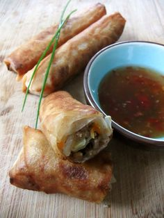 LUMPIA. ( a traditional food from Central Java-Semarang, Indonesia. filled with bamboo shoots, dried shrimp, chicken, and/or prawn. It is served with a sweet chili sauce made from dried shrimp (optional), coconut sugar, red chili peppers, bird's eye chili peppers, ground white pepper, tapioca starch, water, and baby shallots. served either deep-fried or unfried, as the filling is already pre-cooked ).