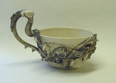 Wheel thrown and altered stoneware mug generously encrusted with sparkplugs, snails, nails, vintage furniture mouldings, pocket watch parts, webby strands, castle nuts and screw heads all modelled in stoneware. Satin glazes in black, white and gray. Multiple high firings have created a rich antique looking surface.  6/15cm tall at handle 6 1/4/16cm diameter 28oz/825ml capacity  To see more of my BioIndustrial inspired pieces, please use this link…