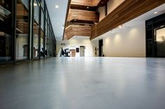 This London Lobby received a brand new remodel. The modern concrete looking seamless floors in combination with the wood panels on the walls round up the contemporary design.