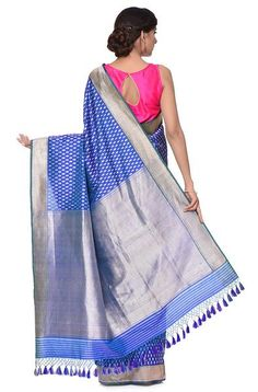 Handwoven kadhwa banarasi saree with delicate sona rupa booti. The saree is woven in royal blue in the warp and bottle green in weft. This is a handwoven product made on traditional looms in Banaras. The yarn used in weaving the product is hand spun. What may appear as slight irregularities in weave. Saree - 5.5 Meters, Blouse Piece - 90 Cms - 1 Meter * Blouse piece included * Care Instructions :Dry Clean only  Price includes domestic shipping charges.