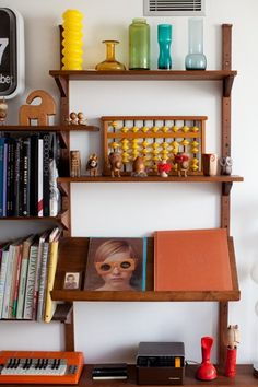 Inside The Whimsical World Of Star Stylist Shirley Kurata  #refinery29  http://www.refinery29.com/my-style-shirley-kurata#slide-3  Mixing tchotchkes with books (organized by color, no less!) brings the perfect blend of form and function to any bookshelf.Photographed by Maia Harms