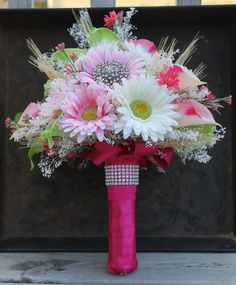 Pink and lime green bridal bouquet with calla lilies and daisies! That pop of rhinestone brings in feminine class!