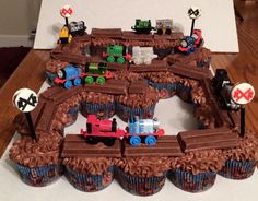 Birthday train cake from cupcakes and Kit-Kats. I shared this on Facebook not sure who gets credit for making it (some cake baker in Mississippi).but the shared post was deleted.