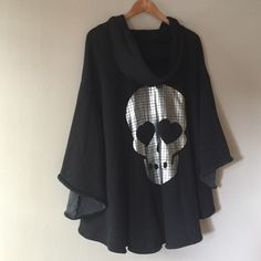"HPAmazing Wildfox Love Skull Poncho Host Pick - ""Insta-Chic"" Uber stylish Wildfox signature skull! Not to mention how cozy and versatile this is. Can fit up to large. Offers welcome. Bundle 3 items right now and get 30% off. Follow me on IG @tijanala. Happy Poshing!  Wildfox Sweaters Shrugs & Ponchos"