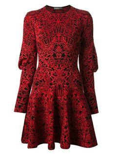 Red and black wool sweater dress from Alexander McQueen featuring a crew neck, long sleeves leg-o-mutton, and a skater fit