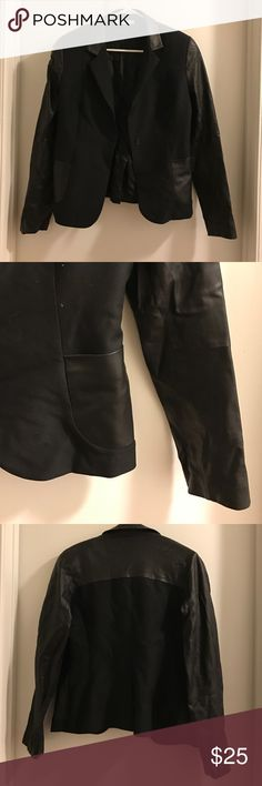 Blazer with leather detailing One button blazer. Fabric blazer with faux leather collar, sleeves and pockets. No tags, not sure about size or actual material. I'm guessing it's a small or medium.Very good condition, only worn a few times. Morris Janks brand. Shoulder to bottom measures 24 inches. Chest measures about 19 inches Jackets & Coats Blazers