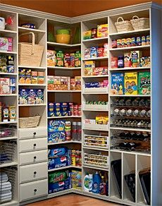 My kind of pantry.. Even spots for those hard to store baking sheets! I so love this!