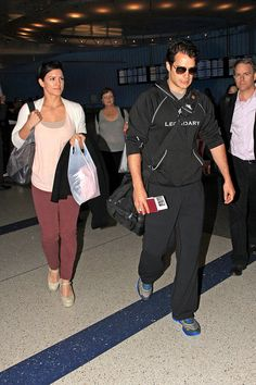 Henry Cavill and girlfriend Gina Carano arrive in LAX on 3-29-13 from Japan - 09 by Henry Cavill Fanpage, via Flickr