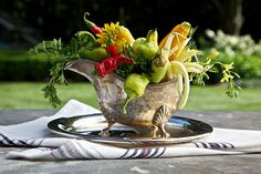 Finally a good use for that silver gravy boat! A mix of peppers, parsley, and other vegetables look just as pretty as flowers.