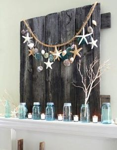 love me some mason jars and some coastal plus some natural wood!  it's all in their girlies...starfish, garland, driftwood and tealights... xo