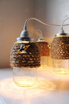 The Hive - Quart Size Mason Jar Pendant Light - UpCycled Handcrafted BootsNGus Lighting Fixture Wrapped in Rope Design via Etsy. Mason Jar Candle Holders, Rustic Candle Holders, Mason Jar Lamp, Quart Size Mason Jars, Quart Jar, Mason Jar Pendant Light, Diy Luminaire, Hanging Light Fixtures, Mason Jar Crafts