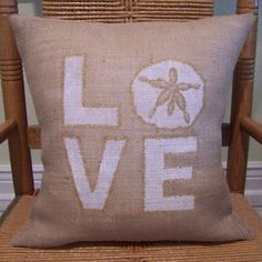 Our decorative burlap pillow cover is sure to add the perfect sea side feel to your home. Made from natural burlap fabric. The love and sand dollar silhouette is hand painted onto each cover from a stencil and trimmed in metallic gold . The cover that is shown in photo is in white and metallic gold and can be made in different colors to match your décor.  *Please note that each pillow cover is hand painted, so it may vary slightly in color shading, angle and spacing. If you have a preference…