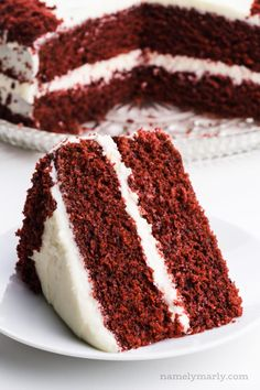 The most AMAZING Vegan Red Velvet Cake is moist, soft, cake, topped with a simple homemade vegan cream cheese frosting. This easy red velvet cake has a perfect velvet buttery texture! This homemade red velvet cake is instantly recognizable with its bright red color offset by a white, creamy frosting. #namelymarly #redvelvet #vegancake #veganredvelvet #redvelvetcake #velvetcake Homemade Red Velvet Cake, Vegan Red Velvet Cake, Easy Red Velvet Cake, White Velvet Cakes, Red Cake, Vegan Carrot Cakes, Vegan Cake, Vegan Desserts, Vegan Cheesecake
