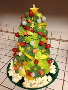 The veggie christmas tree is a unique vegetable and dip platter for a holiday party.
